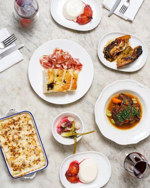 """<p>Got a special occasions to celebrate? Or perhaps you've had to cancel that restaurant reservation you fought tooth and nail due to the dread 'Ping'?</p><p>Dishpatch is the genius new business bringing you meals straight from London's best independent restaurants. Each box, which serves two, is prepped by chefs then boxed up and brought to your door on a Friday morning – just in time for the weekend.</p><p>There is some re-heating involved but, frankly, the result is 1000% better than when you attempt to make something fancy at home. They are professionals, after all.</p><p>Atm, there are some incredible Italian menus created by Angela Hartnett (she's V. famous, guys) of Cafe Murano, as well as a gorg Thai feast by award winning restaurant Farang.</p><p>Boxes start from £50, which is around what you'd pay when out – but once you've added some bargain Aldi wine into the mix, you'll have saved a fortune.</p><p><a class=""""link rapid-noclick-resp"""" href=""""https://dishpatch.co.uk/"""" rel=""""nofollow noopener"""" target=""""_blank"""" data-ylk=""""slk:SHOP HERE"""">SHOP HERE</a></p><p><a href=""""https://www.instagram.com/p/CHBJAxenZL4/"""" rel=""""nofollow noopener"""" target=""""_blank"""" data-ylk=""""slk:See the original post on Instagram"""" class=""""link rapid-noclick-resp"""">See the original post on Instagram</a></p>"""