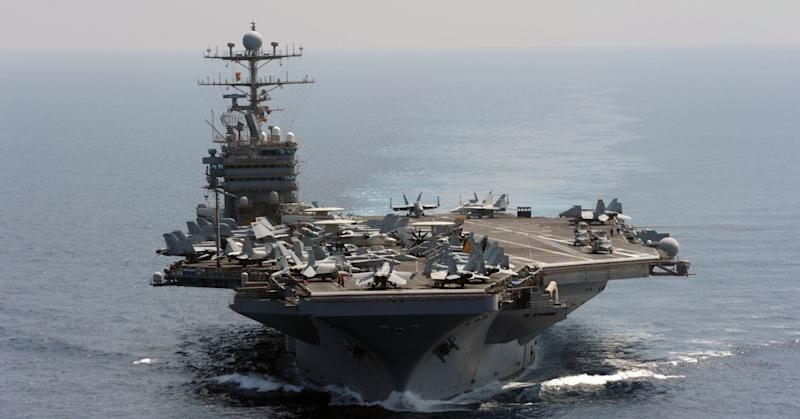 The Nimitz-class aircraft carrier USS Abraham Lincoln transits the Indian Ocean in this U.S. Navy handout photo dated January 18, 2012. The carrier sailed through the Strait of Hormuz and into the Gulf without incident on Sunday, a day after Iran backed away from an earlier threat to take action if an American carrier returned to the strategic waterway.