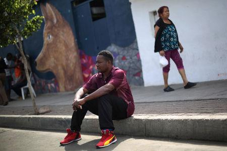 Haitian migrant, Normilus Mondesir, 38, sits outside Juventud 2000 shelter after leaving Brazil, where he relocated to after Haiti's 2010 earthquake, in Tijuana, Mexico, October 7, 2016. Picture taken October 7, 2016. REUTERS/Edgard Garrido