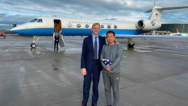 PHOTO: This photo provided by the U.S. State Department, U.S. special representative for Iran, Brian Hook stands with Xiyue Wang in Zurich, Switzerland on Saturday, Dec. 7, 2019. (U.S. State Department via AP)