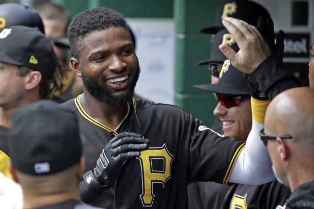 Pittsburgh Pirates' Gregory Polanco celebrates in the dugout after hitting a solo home run off Milwaukee Brewers starting pitcher Chase Anderson in the first inning of a baseball game in Pittsburgh, Saturday, July 14, 2018. (AP Photo/Gene J. Puskar)