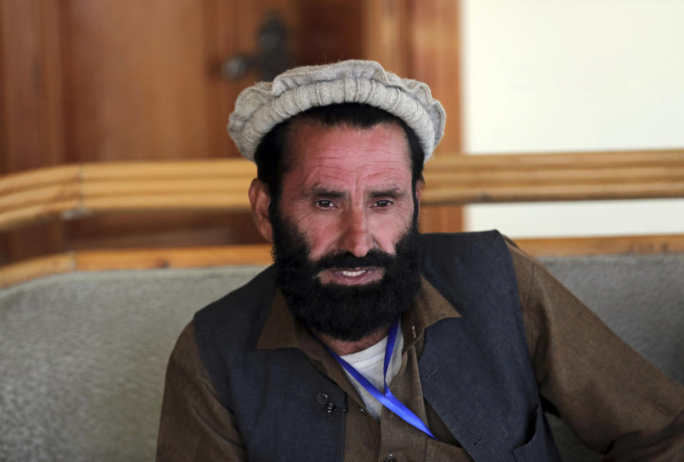 Dawlat Khan, an internally displaced tribal elder, gives an interview to The Associated Press in Kabul, Afghanistan, Tuesday, April 20, 2021. Khan fled his village of Pananzai with his six brothers and their families. Khan still has nightmares about fighters from the local affiliate of the global Islamic State terror network who swept across his and other villages in eastern Afghanistan five years ago. (AP Photo/Rahmat Gul)