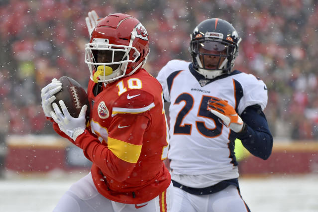 Kansas City Chiefs wide receiver Tyreek Hill (10) makes a touchdown catch in front of Denver Broncos cornerback Chris Harris Jr. (25) during the first half of an NFL football game in Kansas City, Mo., Sunday, Dec. 15, 2019. (AP Photo/Ed Zurga)