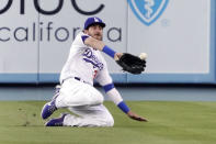 Los Angeles Dodgers center fielder Cody Bellinger makes a catch on a ball hit by San Francisco Giants' Donovan Solano during the first inning of a baseball game Monday, July 19, 2021, in Los Angeles. (AP Photo/Mark J. Terrill)