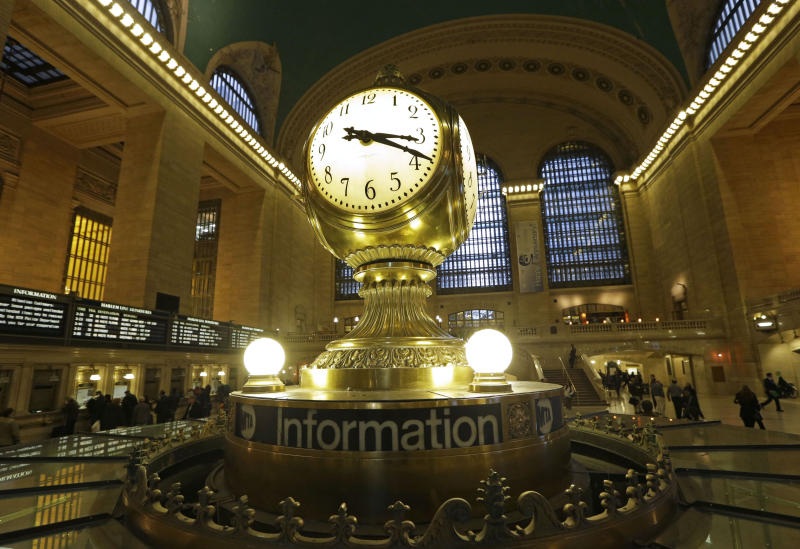 The famous opalescent clock keeps time at the center of the main concourse in Grand Central Terminal is shown in New York, Wednesday, Jan. 9, 2013. The country's most famous train station and one of its finest examples of Beaux Arts architecture in America turns 100 on Feb. 1. The building's centennial comes 15 years after a triumphant renovation that removed decades of grime and decay. (AP Photo/Kathy Willens)
