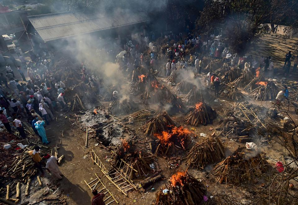 Mass cremation of COVID-19 victims and others takes place at Gazipur Crematorium, in New Delhi, Monday, 26 April 2021.