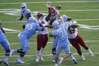 North Carolina State rushes North Carolina quarterback Sam Howell (7) during the first half of an NCAA college football game in Chapel Hill, N.C., Saturday, Oct. 24, 2020. (AP Photo/Gerry Broome)