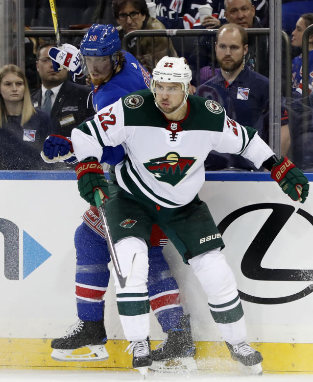 Minnesota Wild right wing Nino Niederreiter (22), of Switzerland, checks New York Rangers defenseman Marc Staal (18) against the boards during the second period of an NHL hockey game in New York, Friday, Feb. 23, 2018. (AP Photo/Kathy Willens)