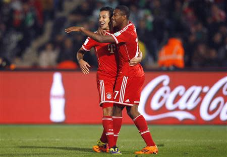 Thiago (L) of Germany's Bayern Munich celebrates his goal against Morocco's Raja Casablanca with his team mate David Alaba during their 2013 FIFA Club World Cup final match at Marrakech stadium December 21, 2013. REUTERS/Amr Abdallah Dalsh