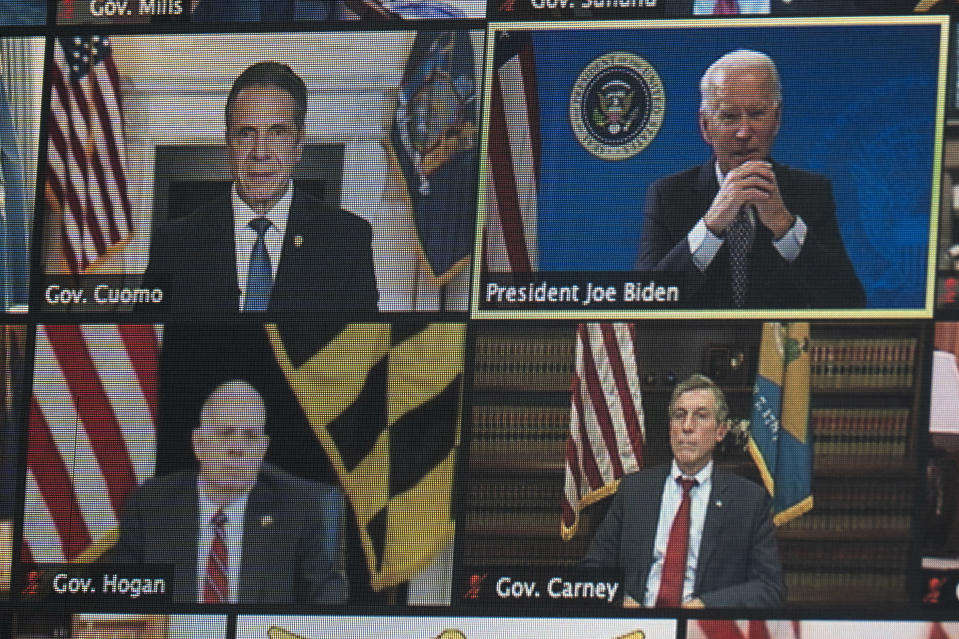 President Joe Biden is seen on a screen as he speaks during a virtual meeting of the National Governors Association, in the South Court Auditorium on the White House campus, Thursday, Feb. 25, 2021, in Washington. (AP Photo/Evan Vucci)