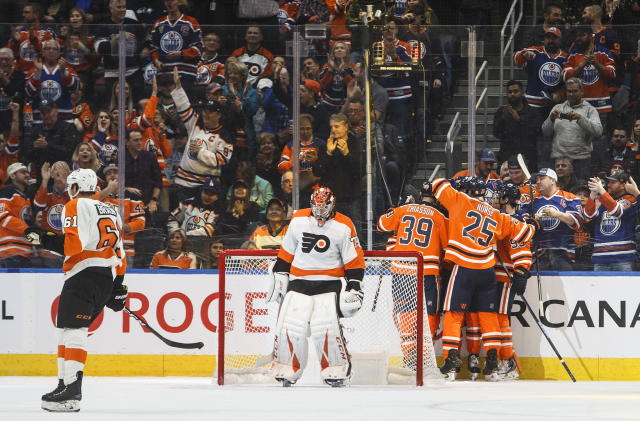 Edmonton Oilers celebrate a goal against the Philadelphia Flyers during the first period of an NHL hockey game Wednesday, Oct. 16, 2019, in Edmonton, Alberta. (Jason Franson/The Canadian Press via AP)