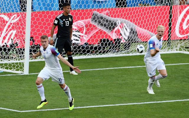 3:26PM 67 mins - Argentina 1 Iceland 1 Messi sends a free-kick over the bar, Iceland race up the other end and win a corner, but it comes to nothing. What a game this is. 3:26PM 65 mins - Argentina 1 Iceland 1 Messi has a history of missing penalties in big moments (see Chelsea 2012 Champions League semi-final, for example), and he's done it again here. It was a decent save but a really poor penalty if you're the best player the world has ever seen. Attempt Saved: Argentina 1 - 1 Iceland (Lionel Messi, 64 min) Gislason replaced Gudmundsson sometime during all that drama. 3:23PM MESSI MISSES THE PENALTY! Halldorsson guesses the right way and Messi's penalty is poor! He palms away and it remains 1-1! 3:22PM Penalty to Argentina! Messi lofts the ball into the box and Magnusson is the wrong side of an Argentina forward. He brings him down and the ref points to the spot! 3:21PM 62 mins - Argentina 1 Iceland 1 A sad sight for Iceland (and Burnley) as Joey Gudmundsson slumps to the turf before limping off injured. He will be replaced shortly, but for now Iceland are playing with 10. 3:19PM 59 mins - Argentina 1 Iceland 1 Messi breaks into some space in midfield, and feeds Banega to his left. He winds up from 25 yards but Ragnar Sigurdsson flies in to block heroically. What a challenge. It's hard to see how these Icelandic players aren't tiring. The work they are putting in is astonishing. 3:16PM 56 mins - Argentina 1 Iceland 1 Messi is growing into this, and he very nearly manages to shake off the two, three, four, maybe five players snapping at his heels on the edge of the Iceland box. He can't quite do it alone, and feeds Aguero, but he has two men on him quickly and the chance is snuffed out. 3:13PM 53 mins - Argentina 1 Iceland 1 Argentina are probing, patiently passing back and forth, across the pitch, but for now at least, they can't find a way through. Manager Jorge Sampaoli decides he needs a bit more creativity in midfield, bringing Ever Banega, more of a No 10, o