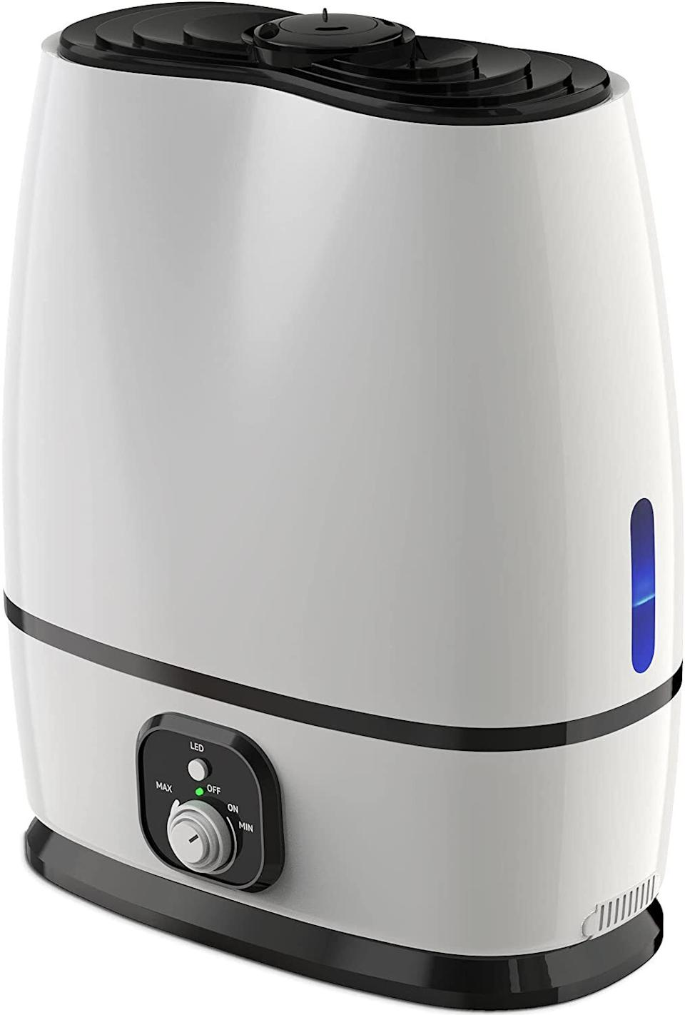 """It comescomplete with an essential oil tray, auto shutoff, night-light and a large-capacity vaporizer.<br /><br /><strong>Promising review:</strong>""""I put this in my bedroom to help with sinus congestion. This thing is powerful. I cranked it up to high and woke up to 58% humidity, which makes you wake up feeling like you inhaled water. Turned it to low and got 49%, which ended up being about perfect. It can run for about three or four nights on low, and the oil diffuser works well if you put enough oil in it. I wake up feeling the least congested in the 48–50% range."""" — <a href=""""https://www.amazon.com/gp/customer-reviews/R3JJDC18QH7ACN?&linkCode=ll2&tag=huffpost-bfsyndication-20&linkId=ab64d4e1195c3069f3a28d4336560b56&language=en_US&ref_=as_li_ss_tl"""" target=""""_blank"""" rel=""""noopener noreferrer"""">Amazon Customer</a><br /><br /><strong><a href=""""https://www.amazon.com/dp/B074MP9DK2?&linkCode=ll1&tag=huffpost-bfsyndication-20&linkId=5c69ba1a86b15e46c4d76732e11de98f&language=en_US&ref_=as_li_ss_tl"""" target=""""_blank"""" rel=""""noopener noreferrer"""">Get it from Amazon for $52.95.</a></strong>"""