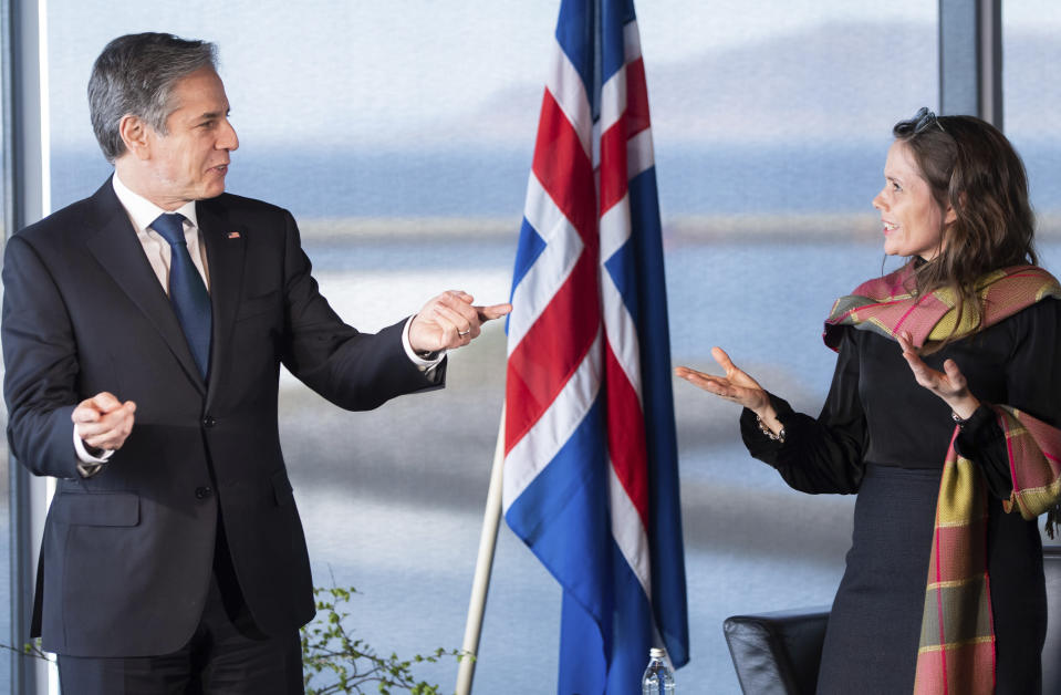 US Secretary of State Antony Blinken, left gestures as he meets Icelandic Prime Minister Katrin Jakobsdottir, at the Harpa Concert Hall in Reykjavik, Iceland, Tuesday, May 18, 2021. Blinken is touting the Biden administration's abrupt shift in its predecessor's climate policies as he visits Iceland for talks with senior officials from the world's Arctic nations. (Saul Loeb/Pool Photo via AP)