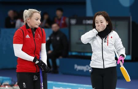Curling - Pyeongchang 2018 Winter Olympics - Women's Bronze Medal Match - Britain v Japan - Gangneung Curling Center - Gangneung, South Korea - February 24, 2018 - Vice-skip Anna Sloan of Britain watches as skip Satsuki Fujisawa of Japan reacts after winning the match. REUTERS/John Sibley