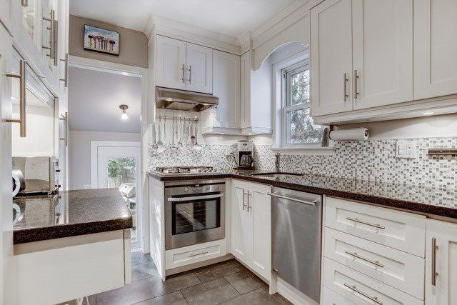 "<p><a rel=""nofollow"">378 Cleveland St., Toronto, Ont.</a><br /> There are heated floors in the kitchen and the bathroom.<br /> (Photo: Zoocasa) </p>"
