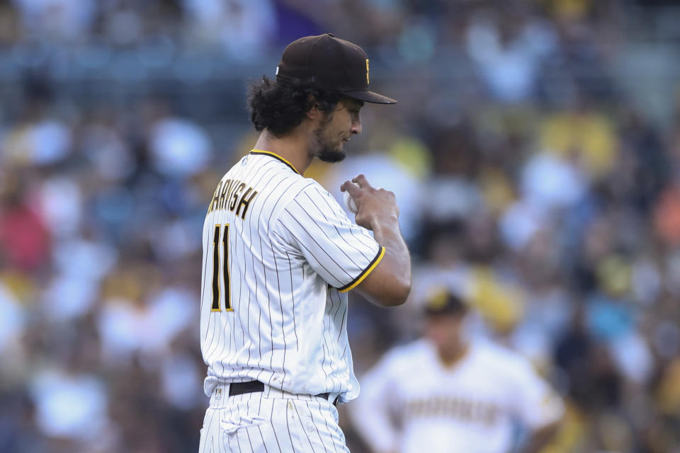 San Diego Padres starting pitcher Yu Darvish reacts after giving up a home run to Colorado Rockies' German Marquez during the fifth inning of a baseball game Saturday, July 31, 2021, in San Diego. (AP Photo/Derrick Tuskan)