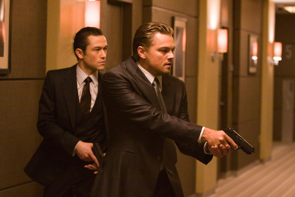 """(L-r) JOSEPH GORDON LEVITT as Arthur and LEONARDO DiCAPRIO as Cobb in Warner Bros. Pictures' and Legendary Pictures' sci-fi action film """"Inception,"""" a Warner Bros. Pictures release."""