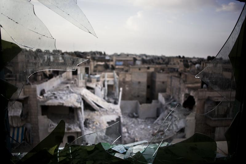 In this Sunday, Oct. 21, 2012 photo, a general view of damaged buildings from shelling in Aleppo, Syria. With death lurking around every corner, the survival instincts of Aleppo's population are being stretched to the limit every day as the battle between Syria's rebels and the regime of President Bashar Assad for the country's largest city stretches through its fourth destructive month. Residents in the rebel-held neighborhoods suffering the war's brunt tell tales of lives filled with fear over the war in their streets, along with an ingenuity and resilience in trying to keep their shattered families going. (AP Photo/ Manu Brabo)