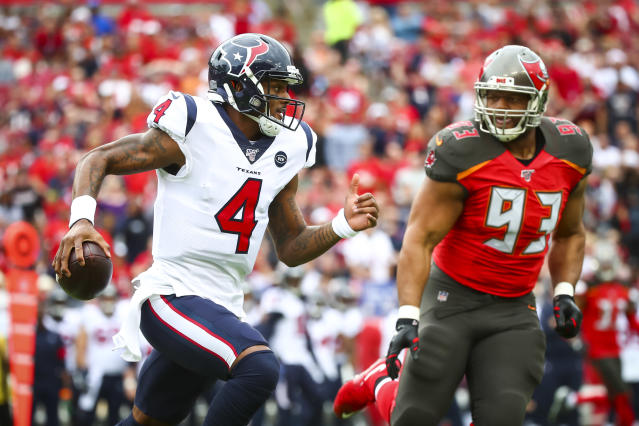 Houston Texans quarterback Deshaun Watson runs with the ball during the first half against the Tampa Bay Buccaneers on Dec. 21, 2019 at Raymond James Stadium in Tampa, Florida. (Will Vragovic/Getty Images)
