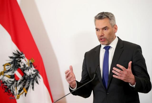 Austrian Interior Minister Karl Nehammer attends a news conference in Vienna
