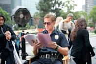 <p>Ryan Gosling reviews his lines before a scene on the set of Drive, which is funny since his character famously said very little. In fact, Gosling only had 116 lines in the entire movie.</p>