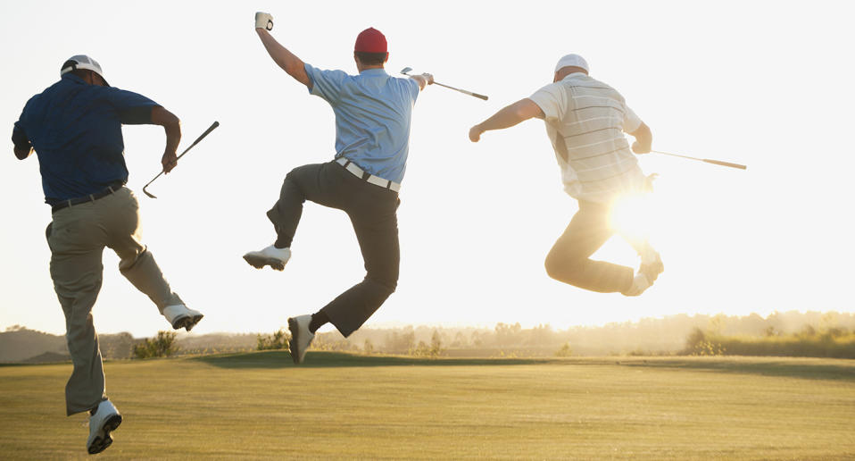 A stock image of three men jumping for joy on a golf course. The trio said they wanted to spend more time golfing now that they were millionaires.