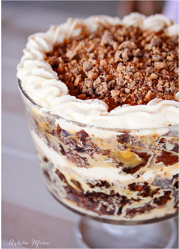 """<p>Coarsely chopped chocolate bars and buttery caramel sauce make this party favorite a sinfully delicious treat. </p><p><strong>Get the recipe at <a href=""""http://ashleemarie.com/sex-trifle-recipe/"""" rel=""""nofollow noopener"""" target=""""_blank"""" data-ylk=""""slk:Ashlee Marie"""" class=""""link rapid-noclick-resp"""">Ashlee Marie</a>.</strong> </p>"""
