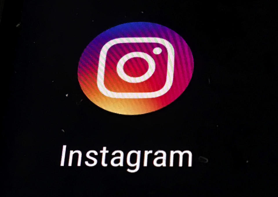 FILE - In this Nov. 29, 2018, file photo, the Instagram app logo is displayed on a mobile screen in Los Angeles. Political adversaries in Congress are united in outrage against Facebook for privately compiling information that its Instagram photo-sharing service appeared to grievously harm some teens, especially girls, while publicly downplaying the popular platform's negative impact. Facebook's head of global safety, Antigone Davis, has been summoned to testify for a hearing Thursday, Sept. 30, 2021, by a Senate panel. (AP Photo/Damian Dovarganes, File)