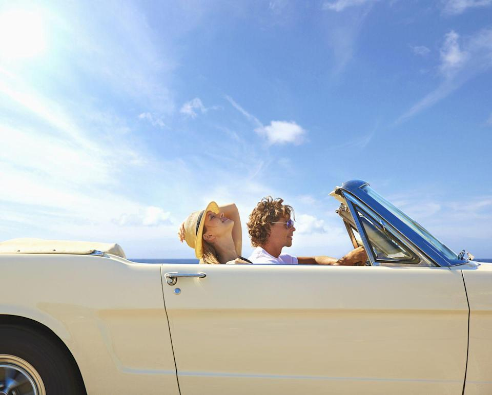 <p>Even if you have to borrow or rent it for the day, you <em>have</em> to say so long to summer with few hours spent in a convertible. For extra glamour, wrap your head in a scarf and apply red lipstick before you hit the road.</p>