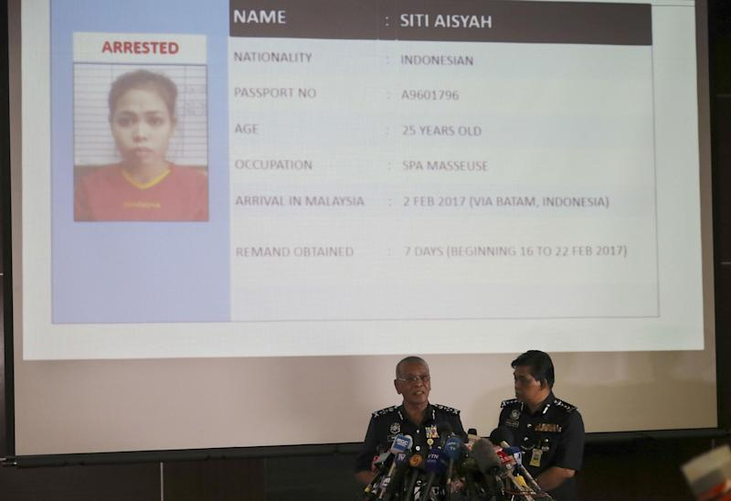 FILE - In this Feb. 19, 2017, file photo, Malaysia Deputy Inspector-General of Police Noor Rashid Ibrahim, left, speaks about detained Indonesian suspect Siti Aisyah, displayed on screen, during a press conference with Selangor state police chief Abdul Samah Mat at the Bukit Aman national police headquarters in Kuala Lumpur, Malaysia. Two women - Siti Aisyah and Vietnamese Doan Thi Huong - have been arrested for allegedly coating their hands with the immensely toxic chemical agent VX and wiping them on the face of the North Korean leader's estranged half brother Kim Jong Nam at Kuala Lumpur's airport. He died within hours. The women told officials from their embassies in Malaysia that they believed the entire operation was a harmless prank for a reality show. Malaysian police say the attackers knew what they were doing and had been trained to go immediately to the bathroom and clean their hands. (AP Photo/Vincent Thian, File)(AP Photo/Vincent Thian)