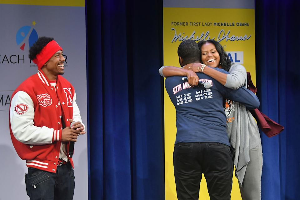 NEW YORK, NY - MAY 05:  Former First Lady Michelle Obama hugs a student onstage during MTV's 2017 College Signing Day With Michelle Obama at The Public Theater on May 5, 2017 in New York City.  (Photo by Mike Coppola/Getty Images for MTV)