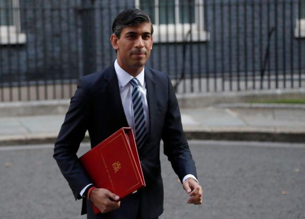 Chancellor of the Exchequer Rishi Sunak walks across Downing Street