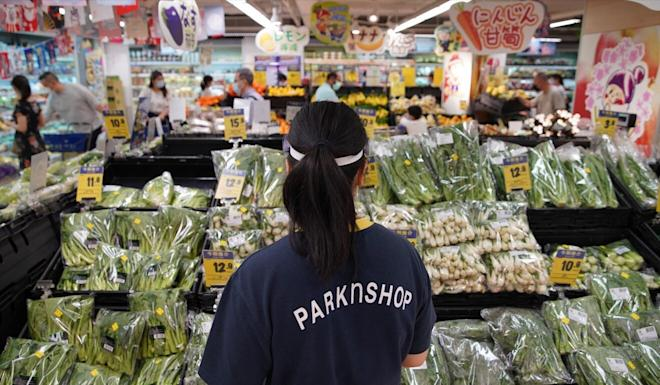 Staff at a ParknShop supermarket in Whampoa on Wednesday. Photo: Winson Wong