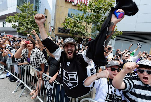 LOS ANGELES, CA - JUNE 14: Fans cheer for the Los Angeles Kings team menbers during the Stanley Cup victory parade on June 14, 2012 in Los Angeles, California. The Kings are celebrating thier first NHL Championship in the team's 45-year-old franchise history. (Photo by Kevork Djansezian/Getty Images)