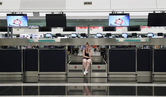 A tourist is left stranded at Hong Kong International Airport after protests grounded flights. Photo: Sam Tsang