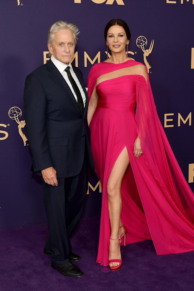 The 49-year-old beauty looked absolutely stunning in a fuchsia gown with a thigh-high slit and caped detailing.