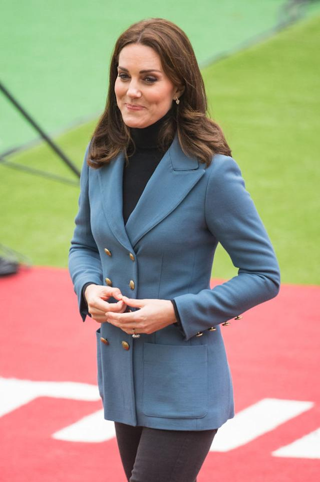 <p><strong>When: October 18, 2017</strong><br />Just a day after announcing the due date of royal baby number three, Kate coyly concealed her growing baby bump in a fitted, double-breasted twill blue blazer by Philosophy di Lorenzo Serafini while making a surprise appearance at the Coach Core graduation ceremony on Wednesday at The London Stadium<br /><em>[Photo: Getty]</em> </p>