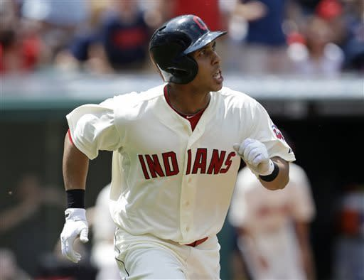 Cleveland Indians' Michael Brantley watches his ball after hitting a three-run home run off Seattle Mariners starting pitcher Felix Hernandez in the second inning of a baseball game on Sunday, May 19, 2013, in Cleveland. Michael Bourn and Jason Kipnis also scored. (AP Photo/Tony Dejak)