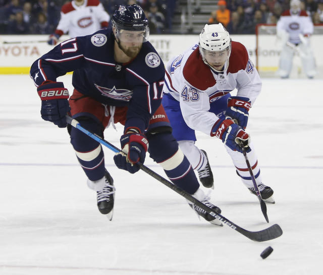 Columbus Blue Jackets' Brandon Dubinsky, left, tries to keep the puck away from Montreal Canadiens' Jordan Weal during the first period of an NHL hockey game Thursday, March 28, 2019, in Columbus, Ohio. (AP Photo/Jay LaPrete)