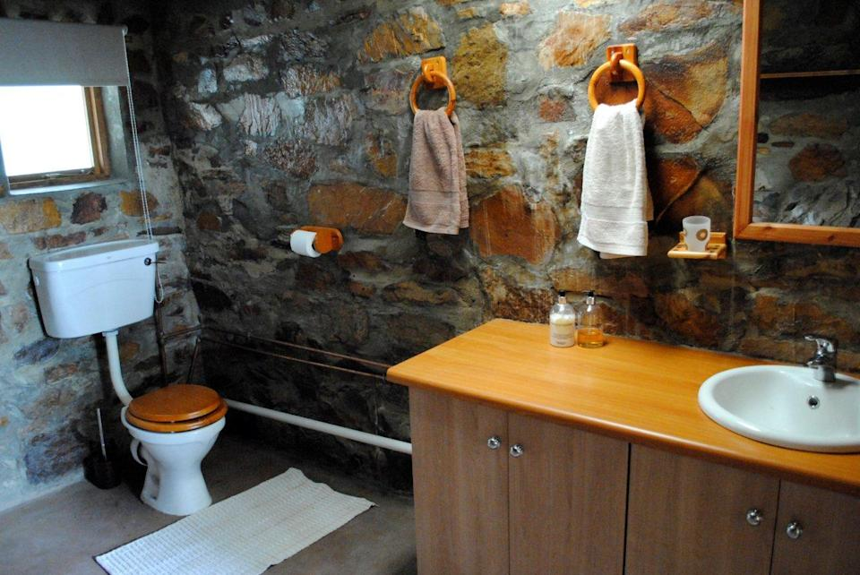 A toilet and basin in the bathroom of the Kliphius guesthouse.