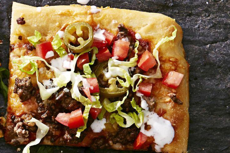 "<p>Your two favorite foods (tacos + pizza) got together to create this Mexican-meets-Italian dinner.</p><p><em><em><a href=""https://www.goodhousekeeping.com/food-recipes/party-ideas/a36232/tex-mex-taco-pizza"" rel=""nofollow noopener"" target=""_blank"" data-ylk=""slk:Get the recipe for Tex-Mex Taco Pizza »"" class=""link rapid-noclick-resp"">Get the recipe for Tex-Mex Taco Pizza »</a></em> </em> </p>"