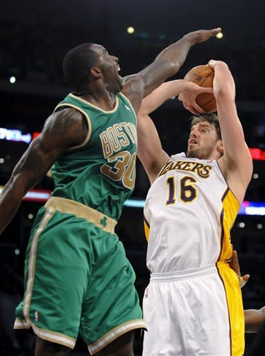 Los Angeles Lakers forward Pau Gasol (16), of Spain, shoots over Boston Celtics forward Brandon Bass (30) in the first half of an NBA basketball game, Sunday, March 11, 2012, in Los Angeles. (AP Photo/Gus Ruelas)
