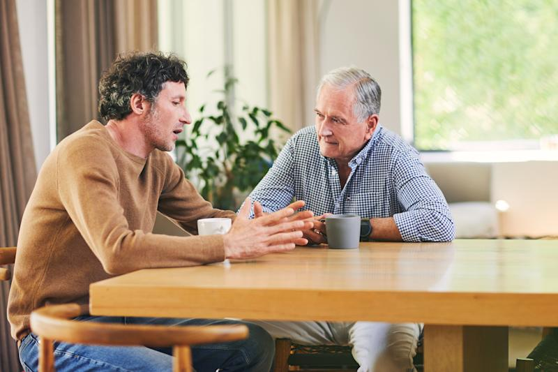 Shot of a mature man and his elderly father having coffee and a chat at home
