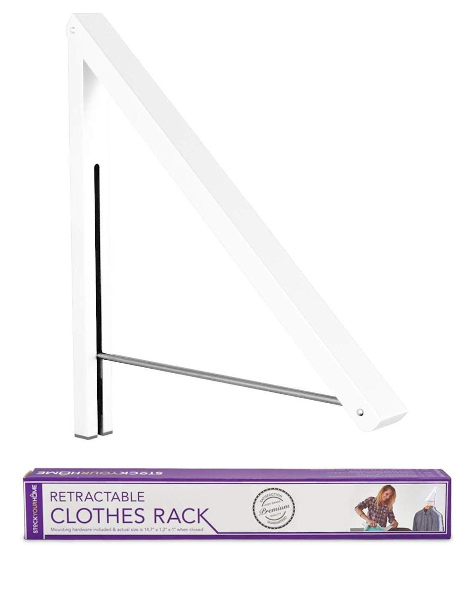 <p>This <span>Stock Your Home Folding Clothes Hanger </span> ($16) is great for a laundry room or corner in your closet. Simply fold it down to hang extra clothes and fold it up when you're done.</p>