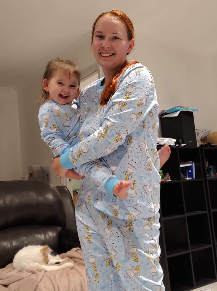 Mum Kasey and her 'mini-me' in matching Alice PJs from Big W. Photo: Facebook (supplied).