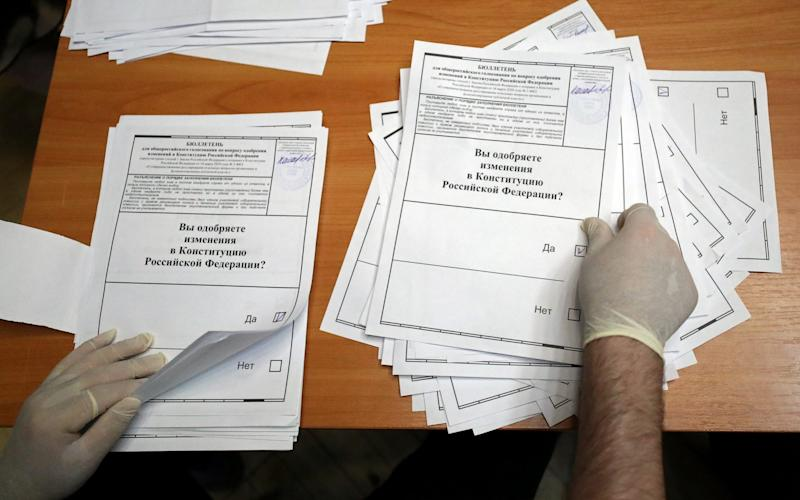 A member of the Electoral Commission counting ballots - Evgenia Novozhenina/Reuters
