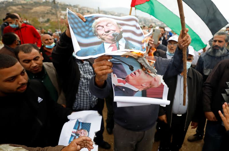 Palestinians protest against Jewish settlements and U.S. President Donald Trump