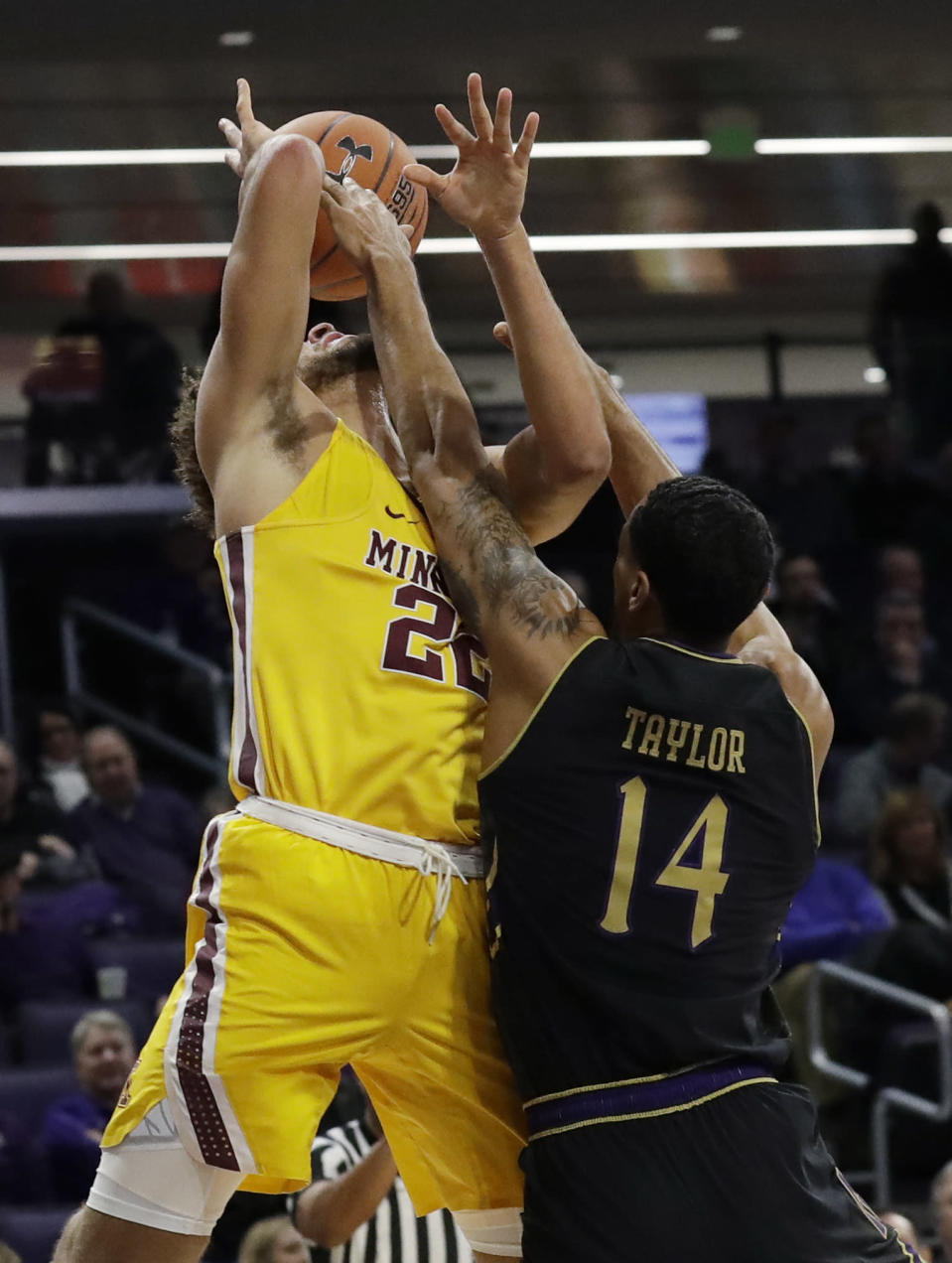 Northwestern guard Ryan Taylor, right, blocks a shot by Minnesota guard Gabe Kalscheur during the first half of an NCAA college basketball game Thursday, Feb. 28, 2019, in Evanston, Ill. (AP Photo/Nam Y. Huh)