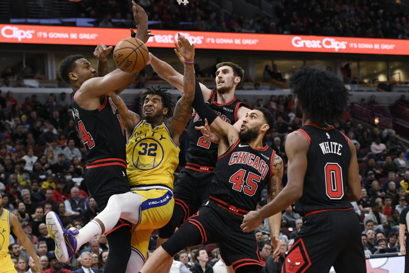 Golden State Warriors' Marquese Chriss (32) battles Chicago Bulls' Wendell Carter Jr. (34), Denzel Valentine (45) and Luke Kornet (2) for the ball while Warriors' Coby White (0) watches during the first half of an NBA basketball game Friday, Dec. 6, 2019, in Chicago. (AP Photo/Paul Beaty)
